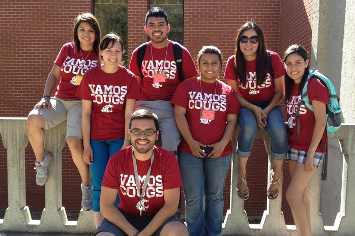 Group picture of students wearing Vamos Cougs shirts.
