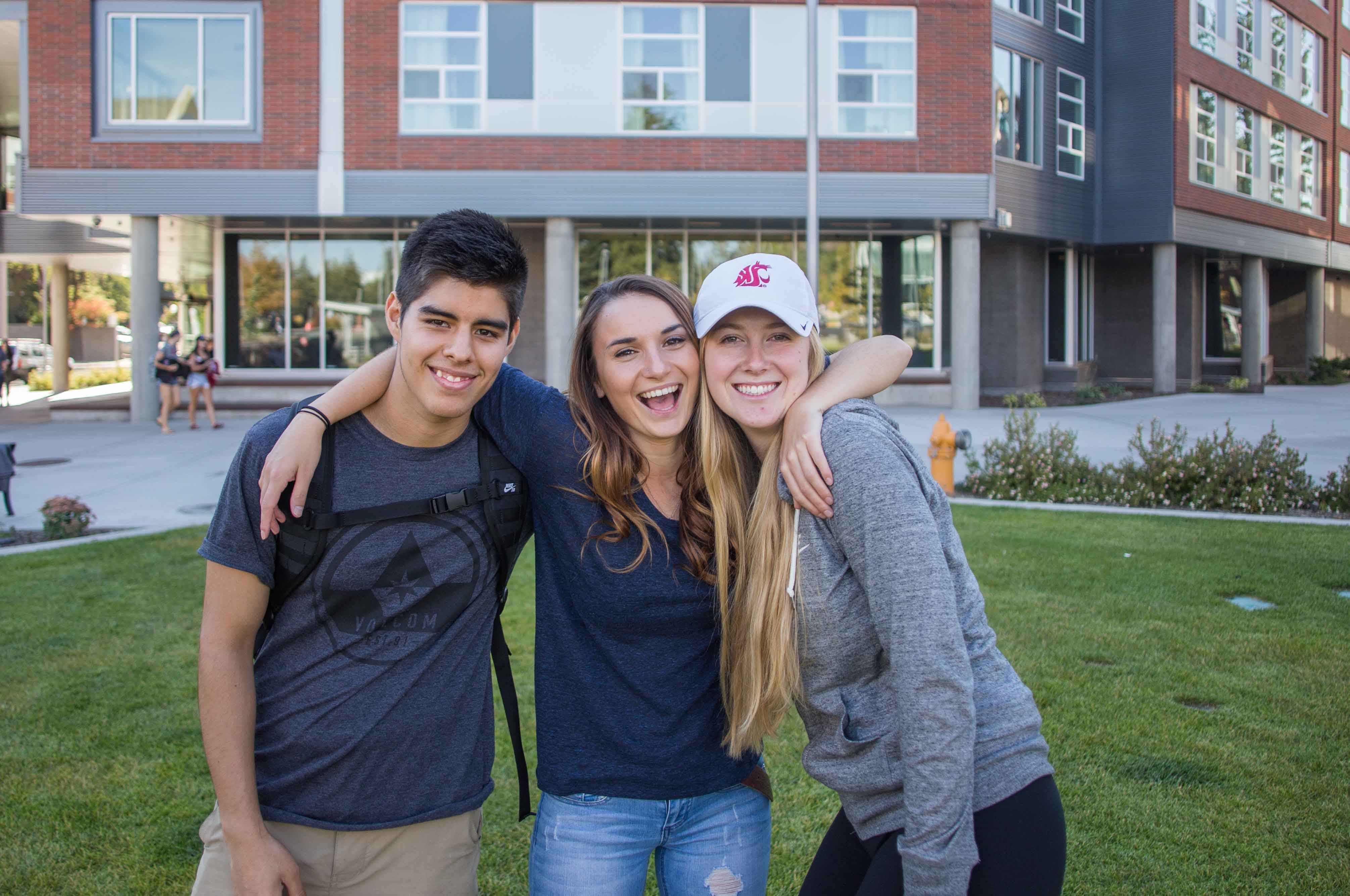 Three students on the Northside Commons.