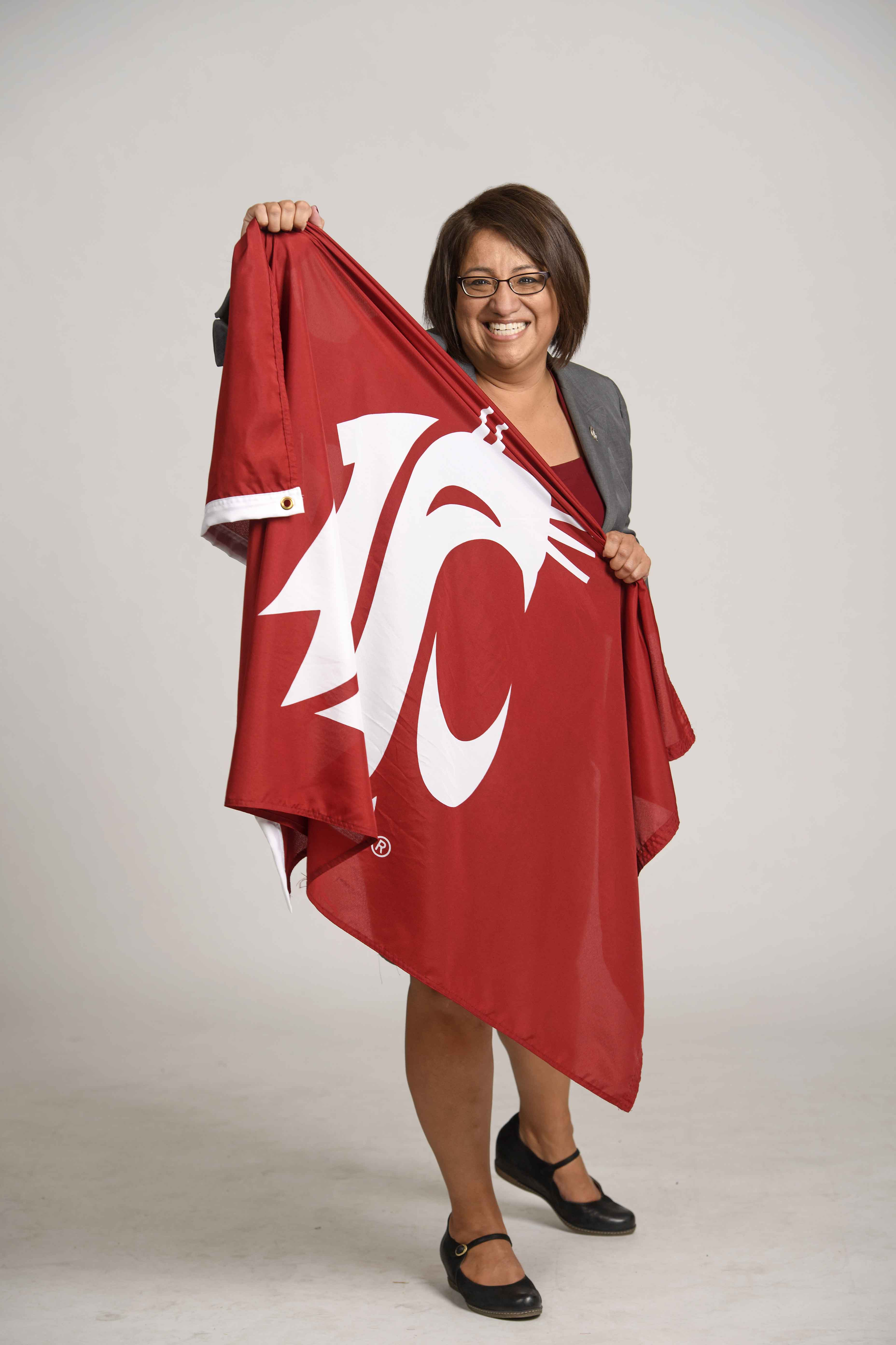 VP Mary Jo Gonzales holding a WSU Flag